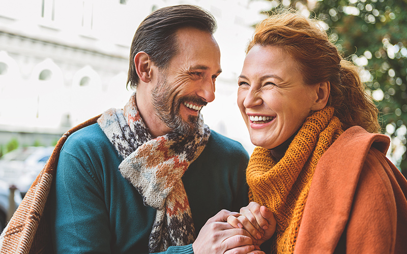 smiling, middle-aged couple